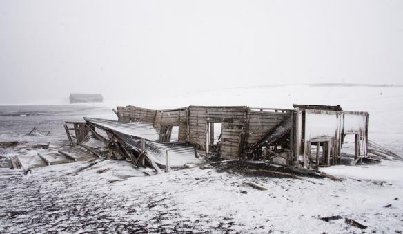 an-abaandoned-whaling-station-biuilding-in-ruins-viewed-in-a-blizzard-deception-island-south-shetlands-archipelago-northwest-of-the-northern-tip-of-the-antarctic-peninsula